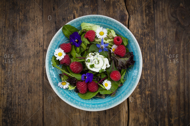 Directly above view of fresh salad in bowl on wooden table