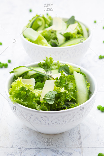High angle view of fresh salad in bowls on tiled floor