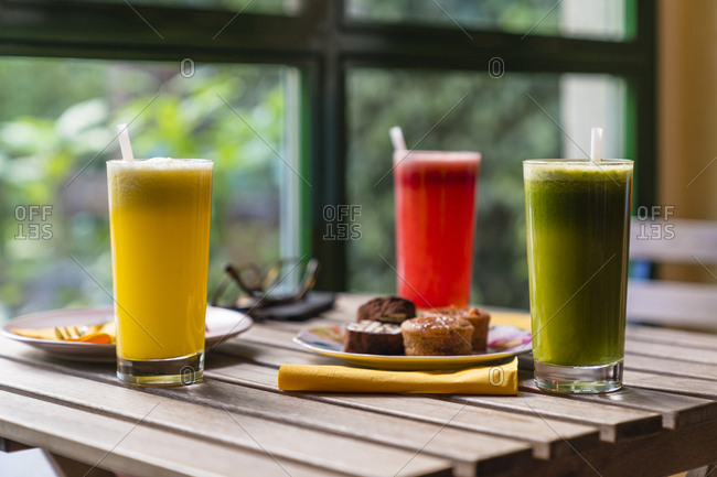 Variation of smoothies and cookies on wooden table