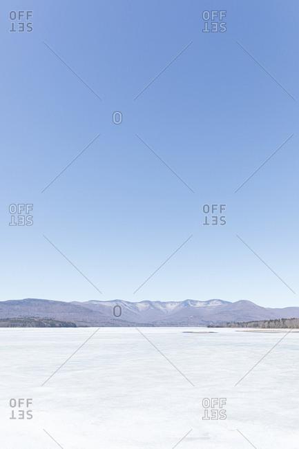Idyllic shot of frozen ice on Ashokan Reservoir against clear blue sky