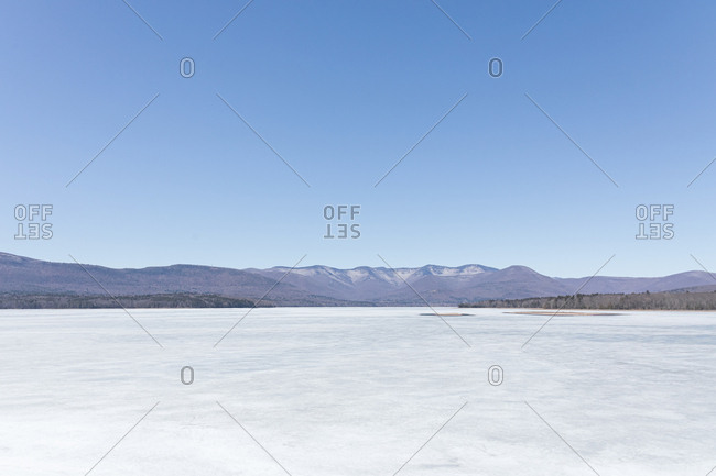 Scenic view of frozen ice on Ashokan Reservoir against clear blue sky