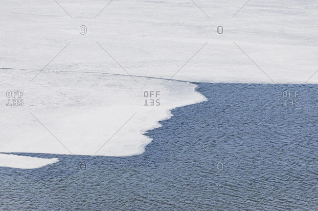 High angle view of frozen ice floating on Ashokan Reservoir on sunny day