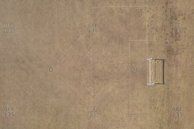 Aerial view of goal post on dry soccer field in summer during drought