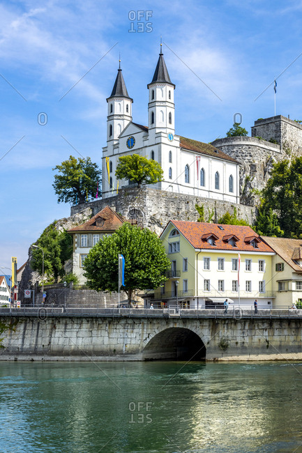 Church and fortress by Aare River in Aarburg against sky
