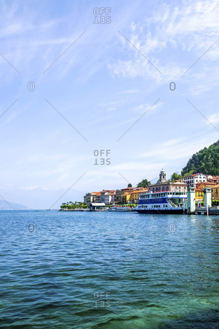 July 15, 2019: Ferry boat moored in Lake Como against blue sky