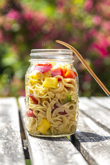 Jar of pasta salad with mango- avocado and cherry tomatoes