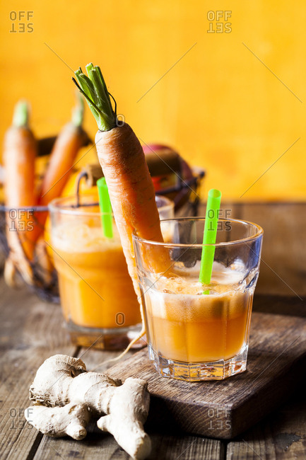 Glass of freshly squeezedĘapple-orange-carrotĘjuice with ginger
