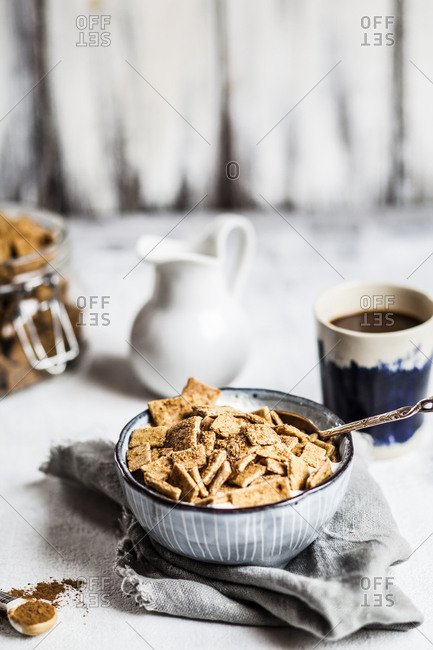 Close-up of fresh homemade baked cinnamon cereals with yogurt in bowl on table