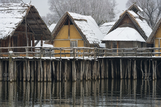 Germany- Baden-Wurttemberg- Snow covered stilt houses on Lake Constance