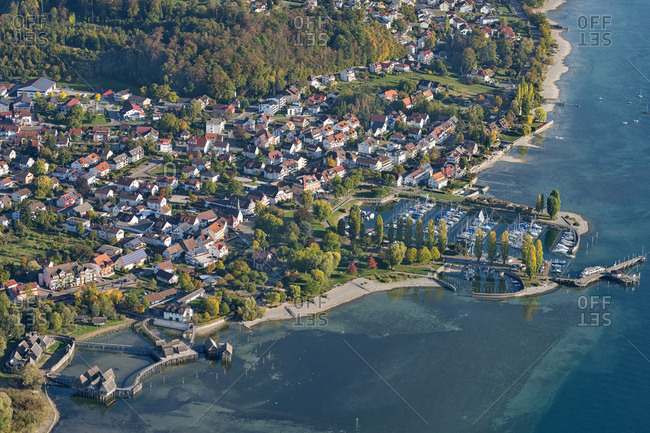 Germany- Baden-Wurttemberg- Aerial view of stilt houses and town on Lake Constance
