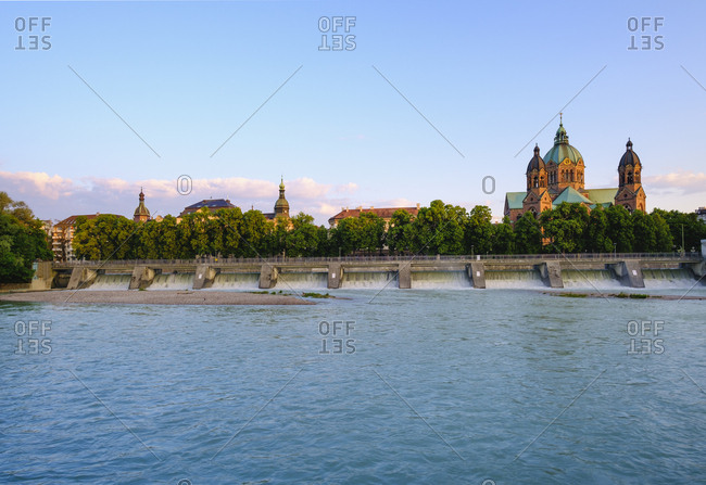 Germany- Upper Bavaria- Munich- Tower and dome of St. Luke's Church seen across Isar river