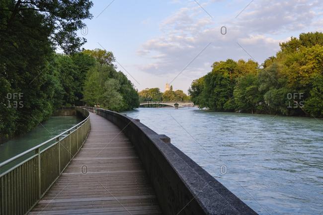 Germany- Upper Bavaria- Munich- Boardwalk on Isar river with Kabelsteg bridge and Deutsches Museum in background