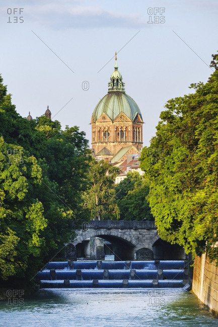 Germany- Upper Bavaria- Munich- St. Luke's Church with Isar river and Maximiliansbrucke in foreground