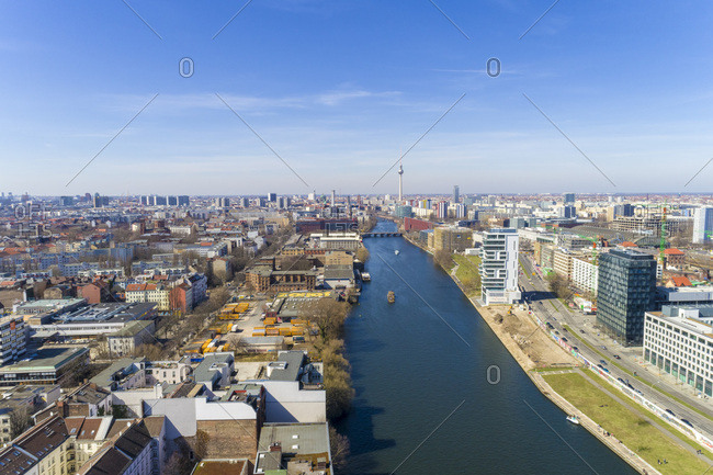 April 7, 2018: High angle view of river amidst buildings in Berlin against sky