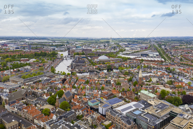 Aerial view of Haarlem city against cloudy sky