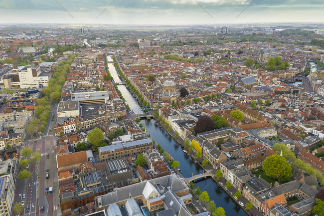 May 5, 2019: Aerial view of canal amidst Leiden city