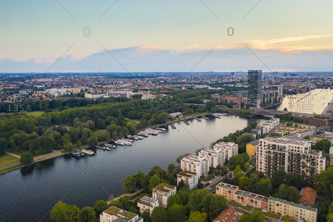June 13, 2019: View of Berlin Treptower Park With City Skyline against sky during sunset
