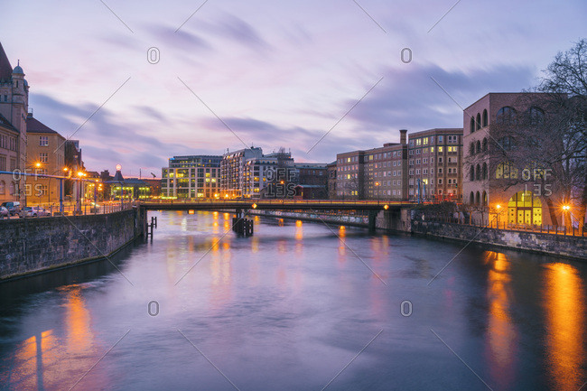 December 22, 2017: View from the Museumsinsel on the Spree towards Friedrichstrasse at sunset- Berlin- Germany