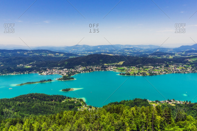 Scenic view of islands in Lake Worthersee from Pyramidenkogel tower against sky