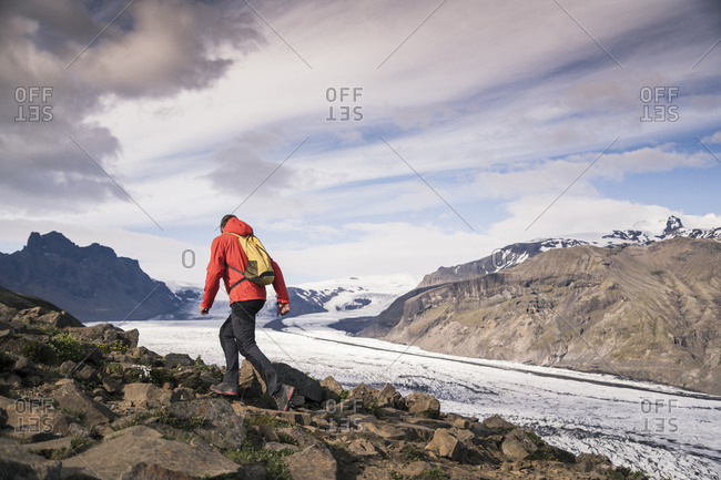 Mature man hiking at Skaftafell National Park along Vatnajokull glacier- Iceland