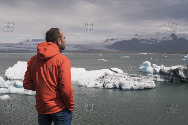 Mature man watching Vatnajokull glacier- Iceland