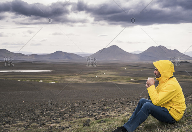 Mature man taking a break- drinking coffee- Iceland