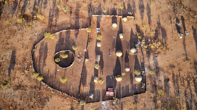 Aerial view of Txitundo Hulo- village Kimbos- surrounded by village fence- in Angola