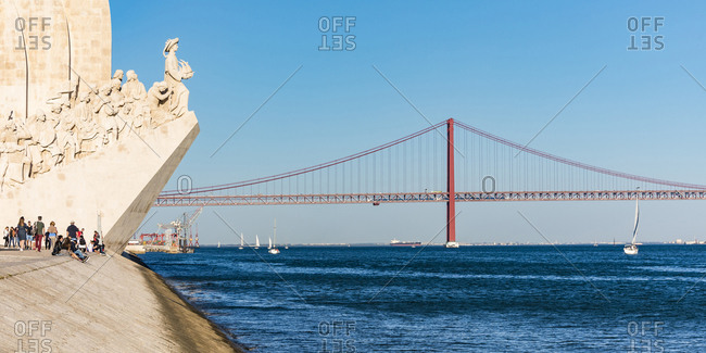 March 27, 2019: Portugal- Lisbon- Belem- Monument of the Discoveries and 25 de Abril Bridge on Tagus river