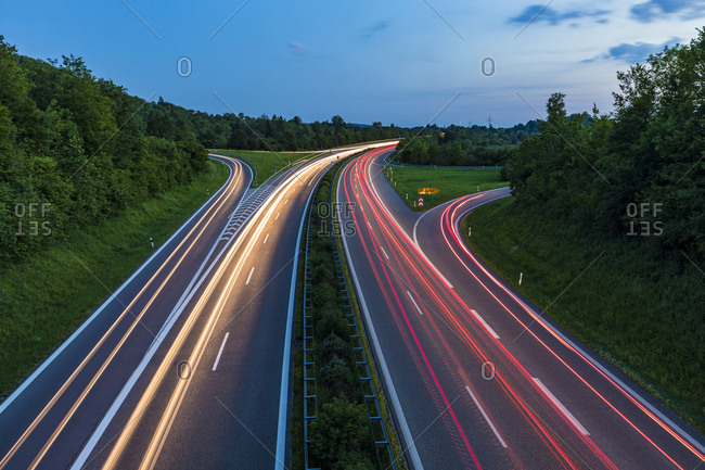Germany- Baden-Wurttemberg- Blurred traffic lights on highway at dusk