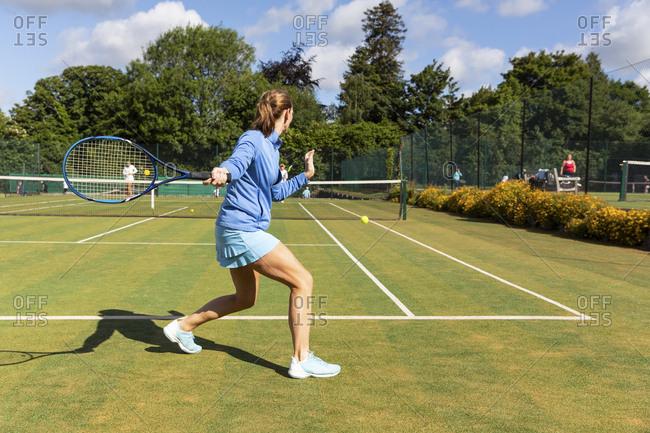 Mature woman during a tennis match on grass court