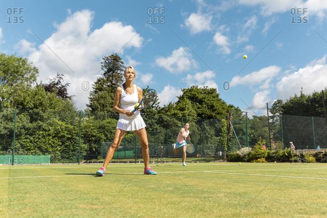 Mature women during a tennis match on grass court