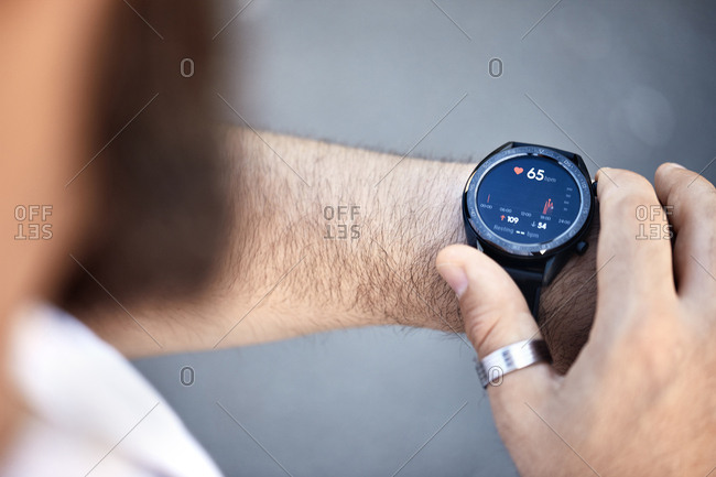 Close-up of man checking medical data on smart watch