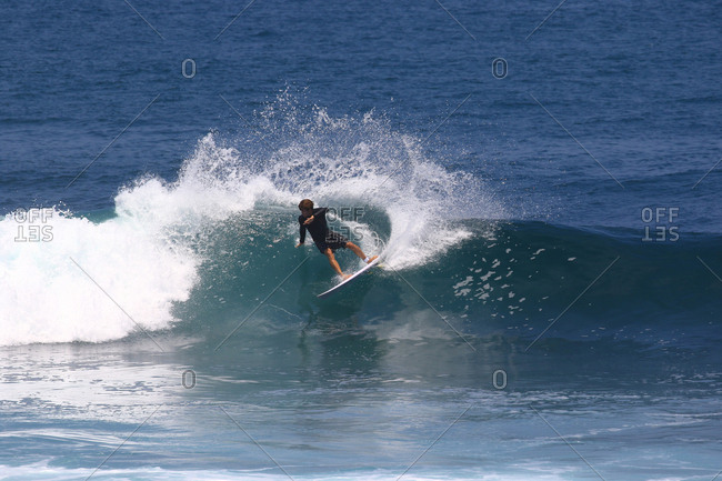 A surfer ripping a wave in Indonesia