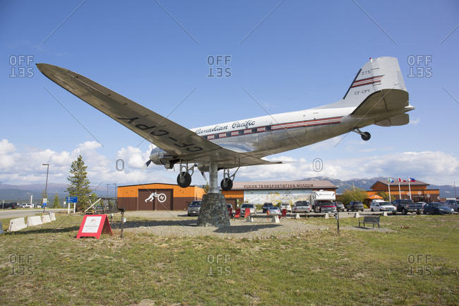 Whitehorse, Yukon, Canada - August 13, 2019: DC3 plane as wind direction indicator at Whitehorse airport in front of the transportation museum