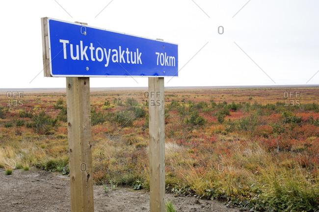 Tuktoyaktuk highway sign in the rural Northwest Territory of Canada