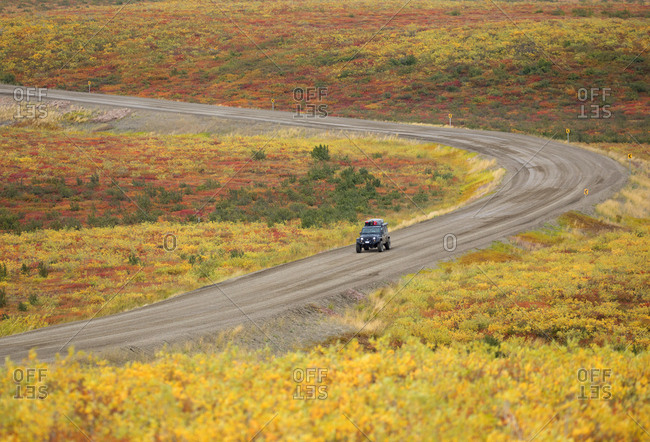 Car driving on Inuvik - Tuktoyaktuk Highway in Northwest Territory, Canada
