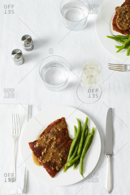 Overhead view of seasoned salmon and green beans