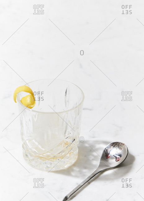 Empty cocktail glass on marble surface