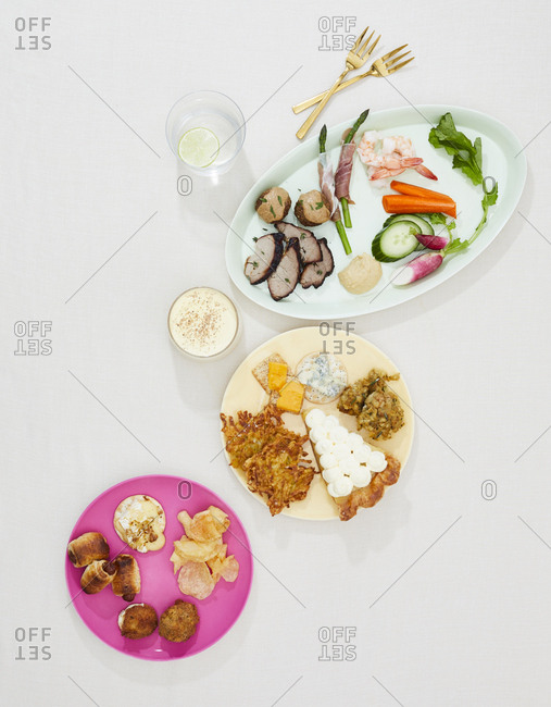 Three course gourmet dishes with drinks on light background