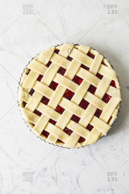 Homemade cherry pie on marble surface