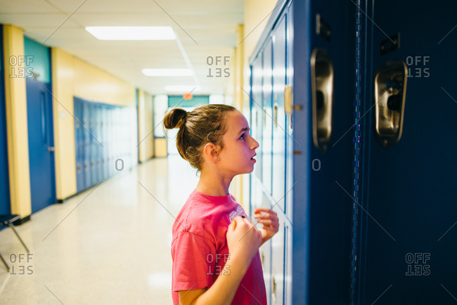 Girl checking out her middle school locker