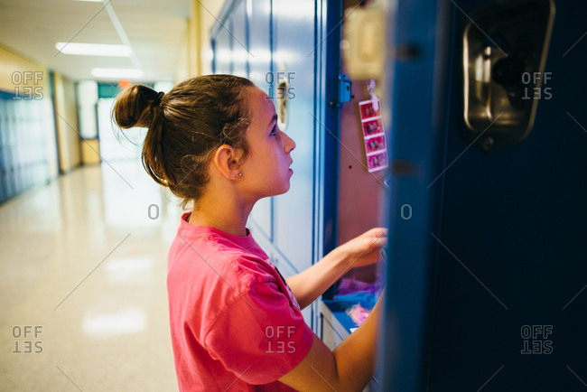 Girl setting up her middle school locker