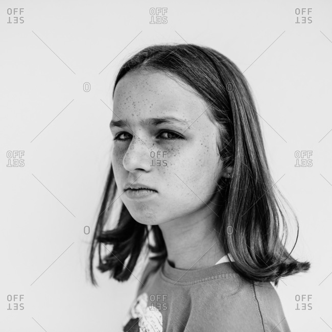 Girl with freckles giving mean stare