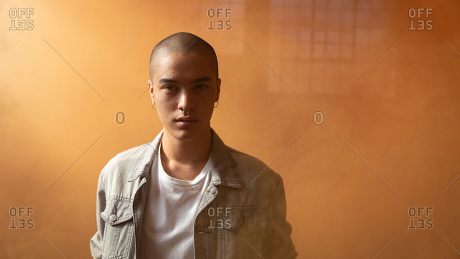 Young man inside an empty warehouse