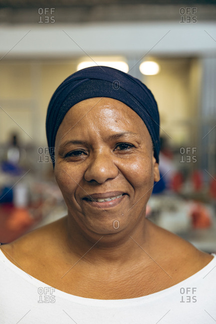Portrait of a middle aged woman in a clothing factory