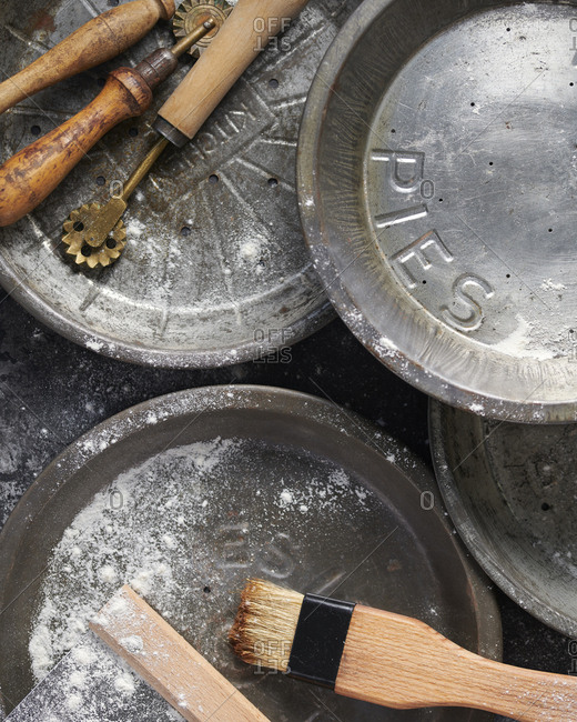 Old baking tins and utensils dusted with flour