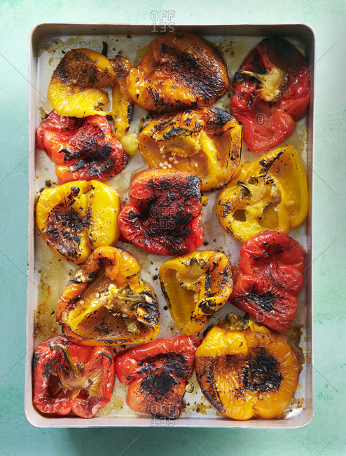 Close up of roast peppers in a baking dish