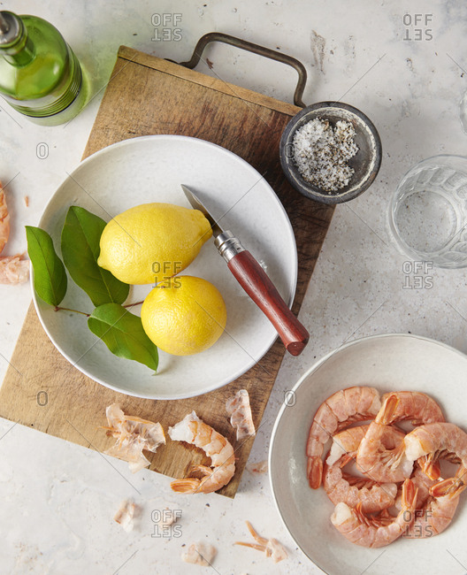 Shrimp and lemons being prepared on a table