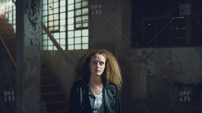 Young woman inside an empty warehouse