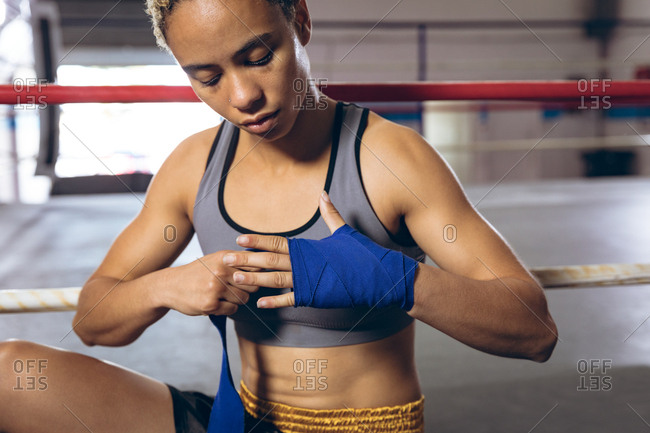 Female boxer wearing hand wrap at boxing club